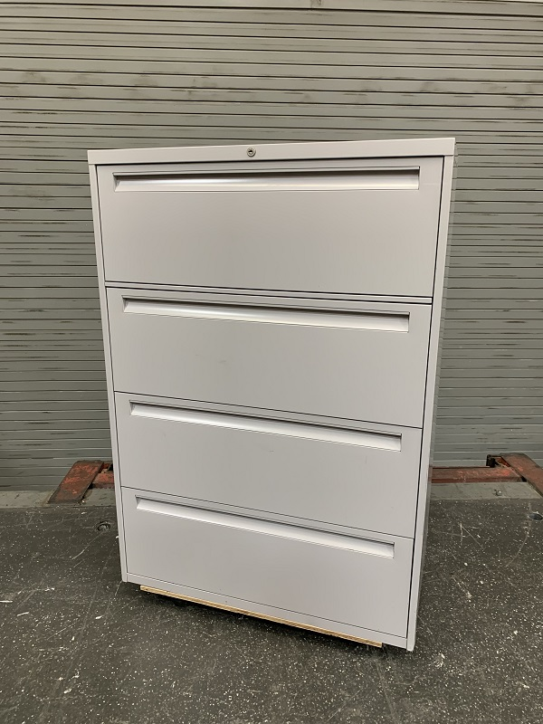 Lateral Filing Cabinet 4 Drawer With A Roll Out Workshelf